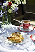 Bread and butter pudding with cream, coffee