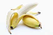 Bananas, unpeeled and partly peeled