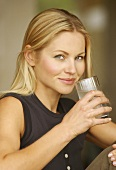 Blond woman drinking glass of water