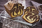 Marble cake, partly sliced, on cake rack