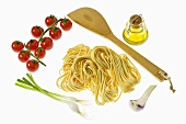 Pasta, vegetables, olive oil and spatula