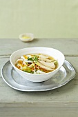 Lemon and ginger soup with chicken and rice ribbon noodles