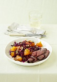 Red cabbage and persimmon salad with roast beef