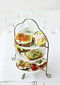 Open sandwiches on tiered stand