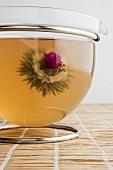 Tea with tea flower in glass jug