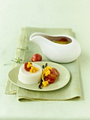 Coconut panna cotta with grape tomatoes and mango