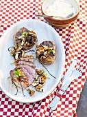 Barbecued pork neck steak with lukewarm mushrooms