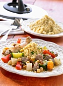 Middle Eastern couscous with fillet of lamb and vegetables