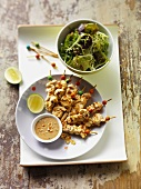 Chicken satay with chilli peanut sauce and salad leaves