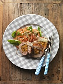 Stuffed breast of veal on tomato salad