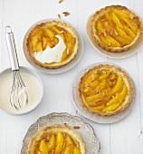 Orange tarts with white wine sabayon