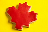 Maple leaf biscuit with red icing