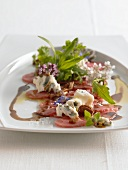 Veal carpaccio with pecan nuts and blue cheese