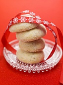 Christmas biscuits, stacked, with red ribbon