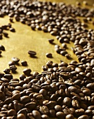 Coffee beans on gold background