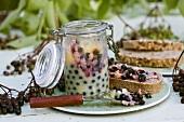 Elderberry butter in jar and on bread