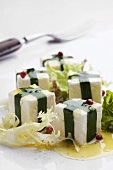 Cubes of sheep's cheese with ramsons, red peppercorns and salad