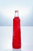 Red vodka in bottle