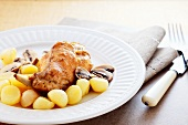 Rabbit leg with button mushrooms and potatoes