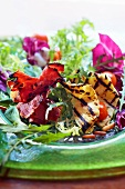 Salad leaves with grilled prosciutto and pineapple