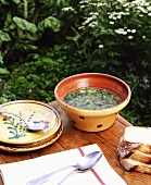 Nettle soup with bread out of doors