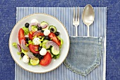 Tomato, cucumber and onion salad with mozzarella and olives