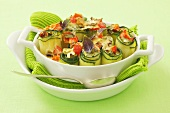 Stuffed courgette rolls with red pepper and melted cheese