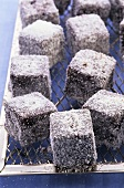 Lamingtons (Cubes of cake coated in coconut, Australia)