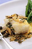 Fish fillet with lemon and caper sauce and flaked almonds
