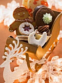Various types of Christmas biscuits in a small sleigh