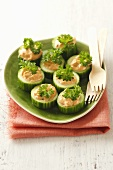 Cucumber slices stuffed with salmon cream