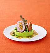 Stuffed lamb steak on pea puree