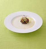 Cheese foam soup with Bündnerfleisch tartare