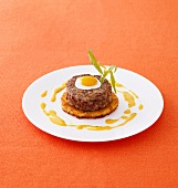 Beef tartare patty on potato cake