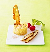 Spicy Obatzda (Camembert spread) with apple in cheese ring, pretzel crisps