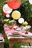 Laid table and party decorations in garden