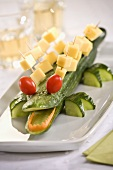 Cucumber crocodile with cherry tomatoes and cheese on cocktail sticks