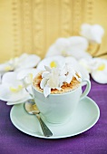 Coconut cream with coconut shavings in a cup