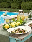 Aubergine & chick-pea salad, fresh lemons & sparkling wine punch by pool
