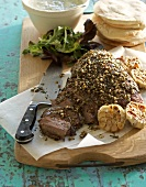 Ostrich fillet with coriander, rosemary and garlic