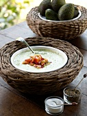 Cucumber and avocado soup with chilli tomato salsa