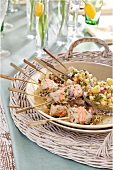 Barbecued salmon and hake kebabs with pineapple salsa