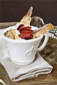 Fruit in red wine with bread and butter pudding and mascarpone
