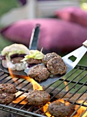 Lamb burgers on barbecue