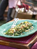 Green asparagus with garlic, breadcrumbs and egg