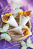 Paper cones of rice with mango and caramel