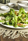 Lettuce hearts with pears, sultanas and nuts