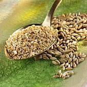 Wheat bran on spoon, grains of rye
