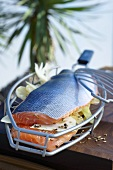 Salmon stuffed with fennel in a grilling basket