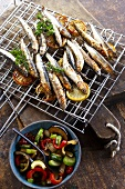 Sardines on a barbeque grill